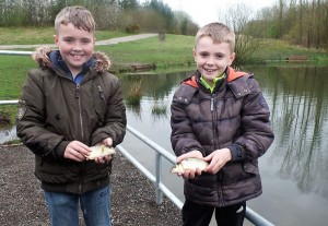 The Arnold brothers - cock a hoop that new fish are being stocked into their local fishing pond
